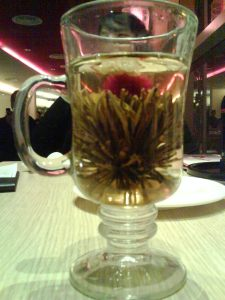 angel's jasmine tea with a very weird-looking plant growing in it!